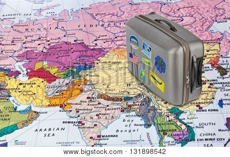 Asia map and case with stickers (my photos) - travel background