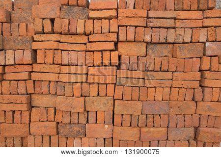 Bricks stacked in piles Or Bricks background