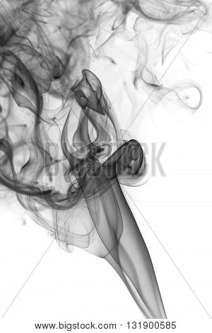 Abstract art. Grey smoke from the aromatic sticks on a white background. Background for Halloween. Texture fog. Design element. The concept of aromatherapy.