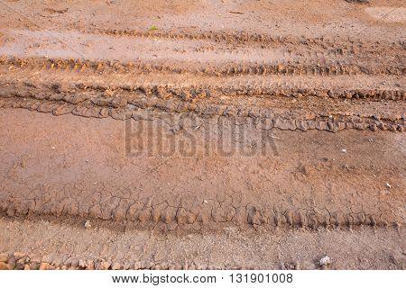 Wheel tracks on the soil, track background