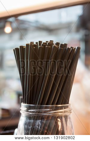 Brown straw in coffee shop, stock photo
