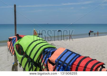 Colorful life jackets on beach in Phuket Thailand