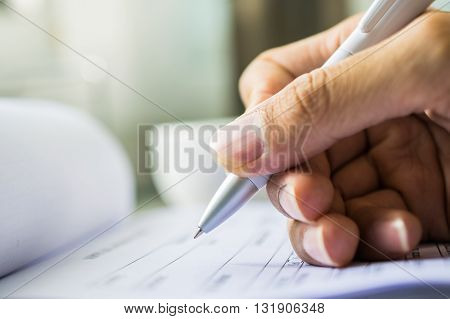 Hand with pen over application form.selective focus