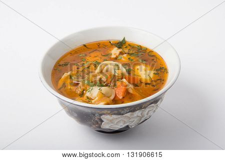 Uzbeck traditional soup on a white background