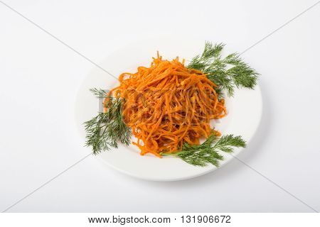 Asian carrot salad with dill on a white plate