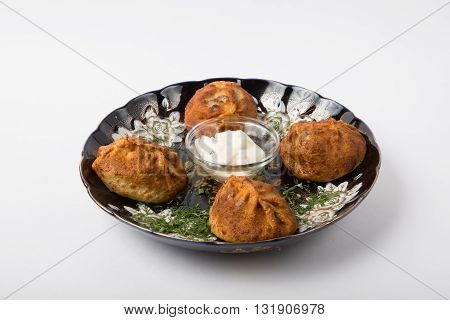 Fried uzbeck momos with sour cream and herbs