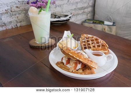 waffle with syrup waffle with ice-cream waffle with strawberry waffle with whip cream waffle on wooden table yummy waffle fresh waffle / ice cream waffle strawberry waffle baked waffle lychee frappe waffle