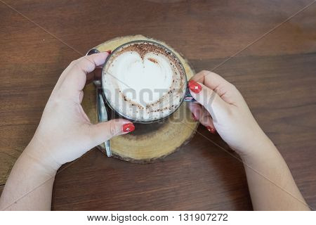 hot coffee fresh coffee coffee in cup heart shape coffee coffee and woman and coffee with red nail coffee ready to drink coffee on the table / hot coffee with heart shape coffee foam