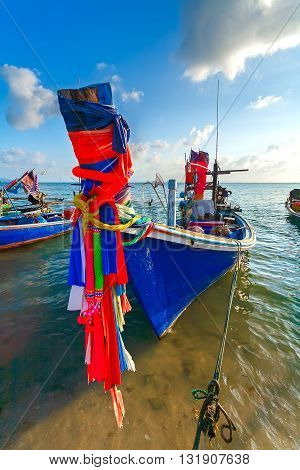 Thai traditional Fishing boat decorated with colorful ribbons