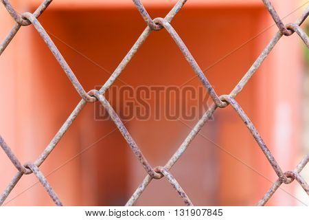 Rusty Old Balustrade Or Iron Bar Pattern On Orange Colour Background, Close-up Rusty Fence