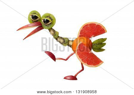 Funny heron made of fruits on isolated background
