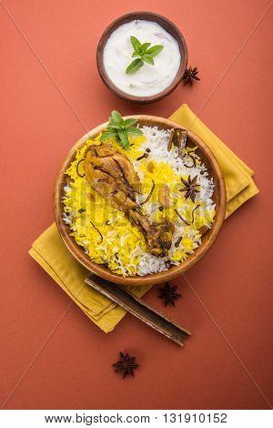 Chicken biryani made in authentic basmati rice and big leg piece, selective focus