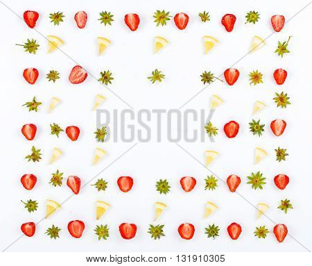 Frame with slices of strawberries and slices of lemon on white background. Flat lay. Top view