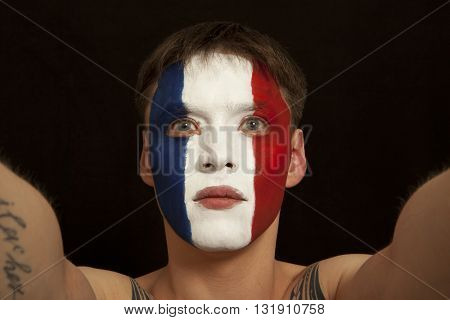 French fans at the stadium. Football, soccer fan. Black background