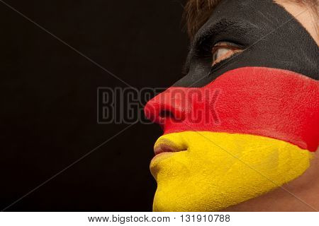 German fans at the stadium. Football, soccer fan. Black background