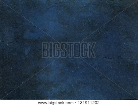Dark blue grunge paper background. Natural old paper texture for the design.