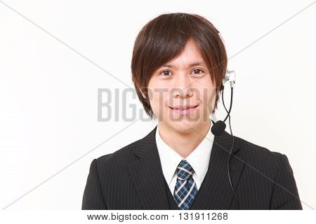 portrait of young Japanese businessman of call center on white background