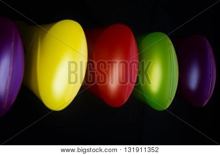 colorful background with plastic bottles in a black background