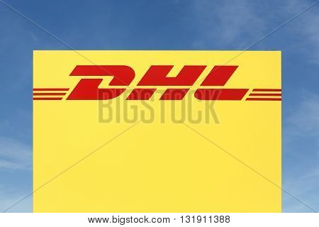 Skanderborg, Denmark - May 26, 2016: DHL logo on a panel.DHL Express is a division of the german logistics company Deutsche Post DHL providing international express mail services.