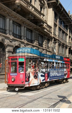Milan, Italy - July 20, 2016: Old and vintage tram on the street of Milan, Italy. The Milan tramway network is an important part of the public transport network of Milan, Italy.