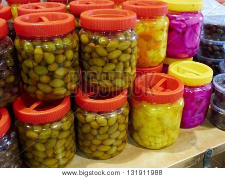 Glass jars with homemade Mediterranean Italian style pickled olives