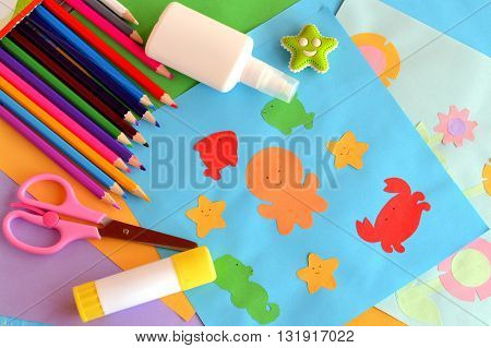 Paper colored sea animals and flowers, paper applique cards. Summer craft idea. Children creativity. Application simple. Glue, scissors, a set of pencils, eraser. Children background