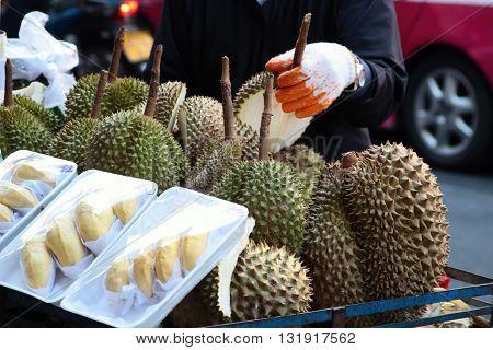 Jackfruit on the street market. Jack fruit and a stallholder. Jackfruit on the fruit stall. Fresh jack fruit.