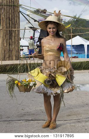 KOH PHANGAN THAILAND - DECEMBER 09 2015 : Unknown Thai woman in traditional costume takes part in the Phangan Color Moon Festival