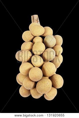 The Longan on a black background .