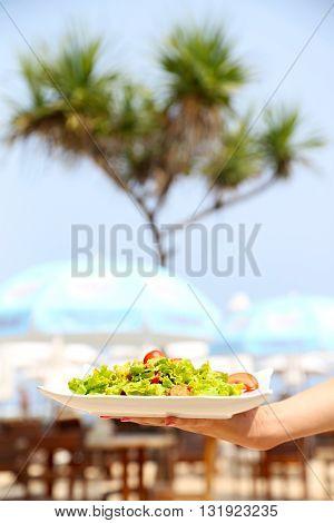 Summer lunch - chicken caesar salad on the white plate