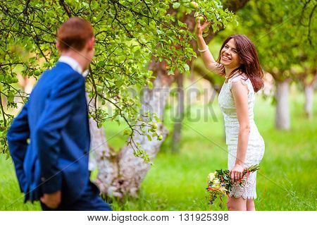 wedding concept. Happy Smiling Couple in love in orchard, spring