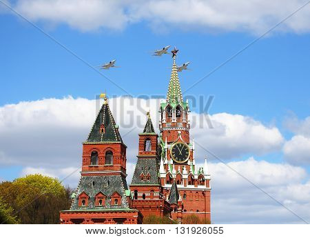 Combat aircraft of the russian Air Force flying over the Moscow Kremlin ancient towers