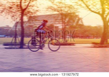 Blurred cycling outdoor exercise in park vintage tone