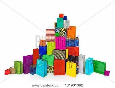 a huge pile of multi-colored bags for shopping isolated on white background