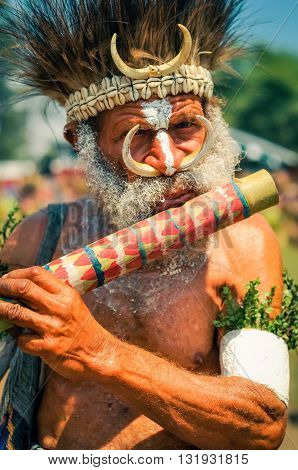 Man With Flute In Papua New Guinea