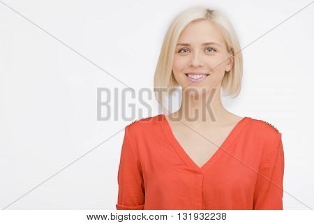 close-up portrait of Happy Young Woman posing in orange On Isolated  Background