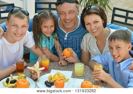 Happy family at breakfast on the table