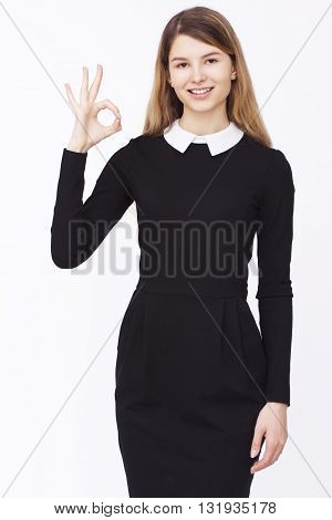 Business. Happy businesswoman gesturing ok or yes on isolated background