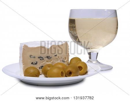 Green olives and cheese on a white plate