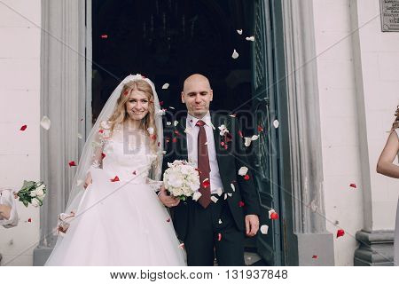 beautiful blonde bride enjoys her wedding day in the summer