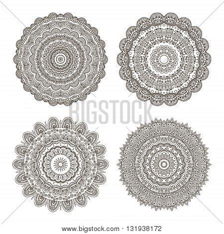 Vector set of hand drawn doodle mandala. Colorful mandala for your design. Black ornamental doily on white background.