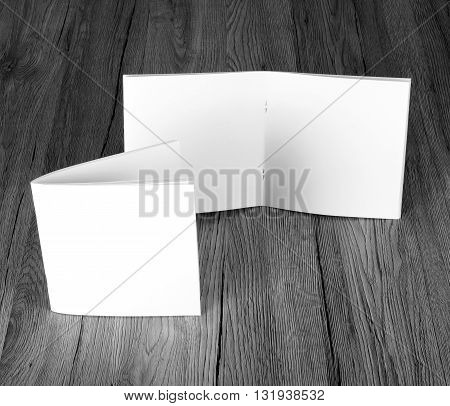 Blank catalog brochure magazines book on wooden background top view