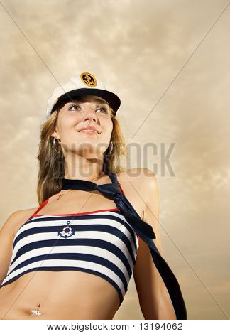 Beautiful girl in captain's hat