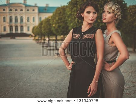 Well-dressed wealthy ladies in a beautiful park