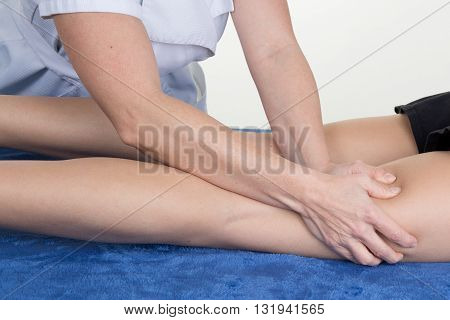Close Up Of Tight Of A Woman Massaging By Therapist