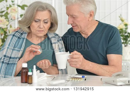 Portrait of a ill senior woman with caring husband
