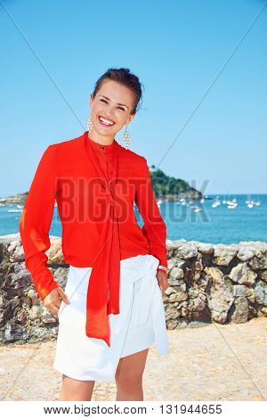 Happy Woman In Front Of Scenery Overlooking Lagoon With Yachts