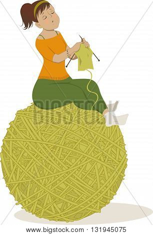 Woman knitting sitting on a ball of yarn