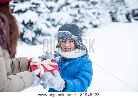 Chil with gift at forest