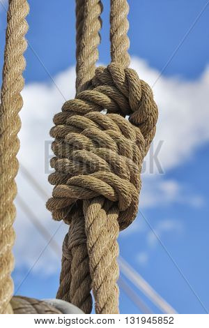 Close-up of vintage marine ropes with nautical knot on old sailing vessel